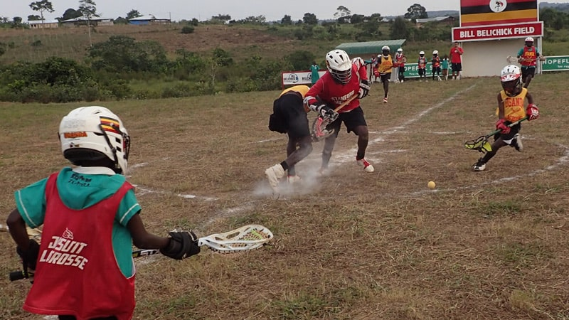 Ugandan boys and girls playing Lacrosse