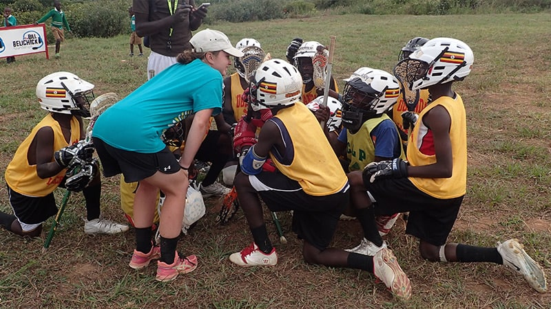 Coaching lacrosse tactics to Ugandan players